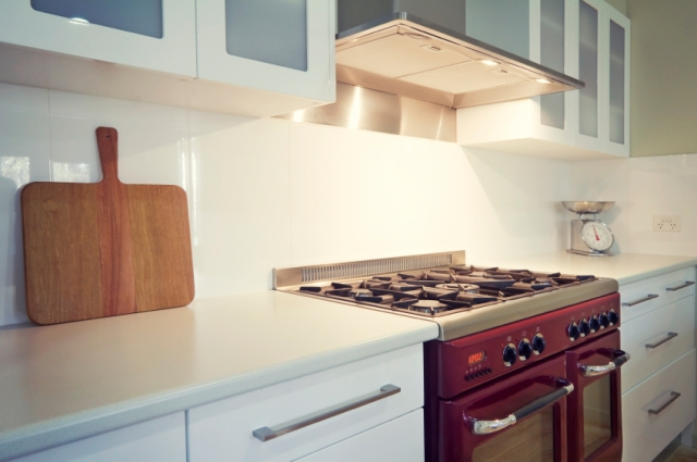 White kitchen with retro vintage burgundy oven